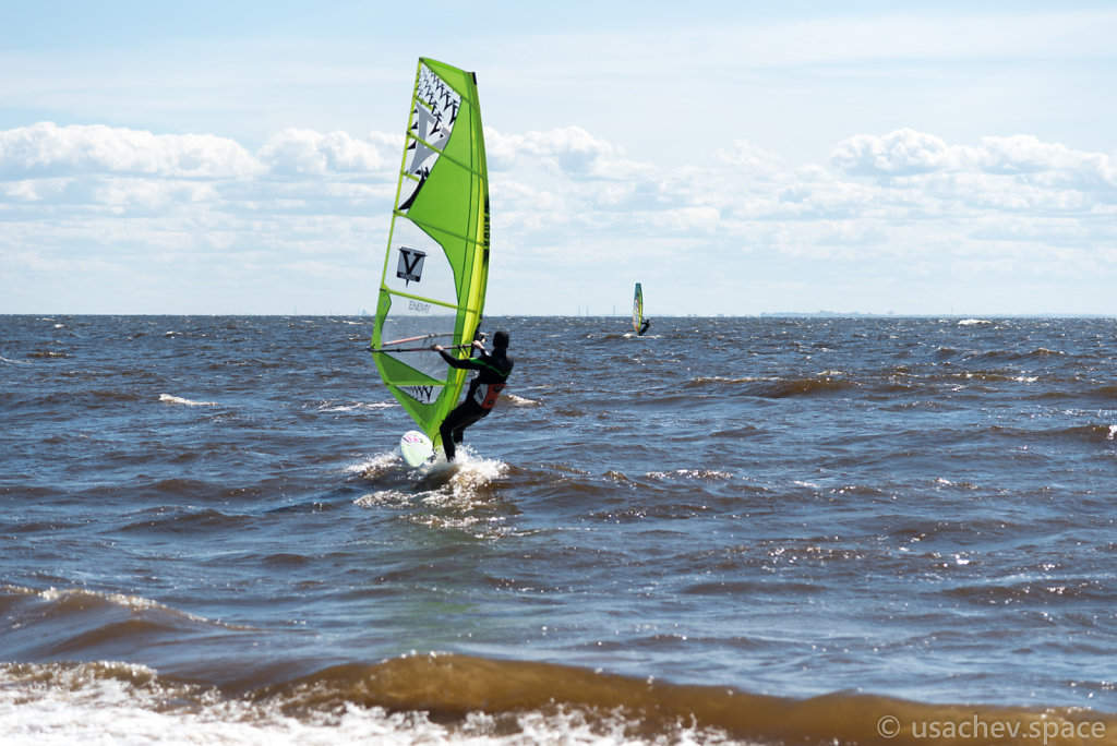 Windsurfing in the waters of the Gulf of Finland against the bac